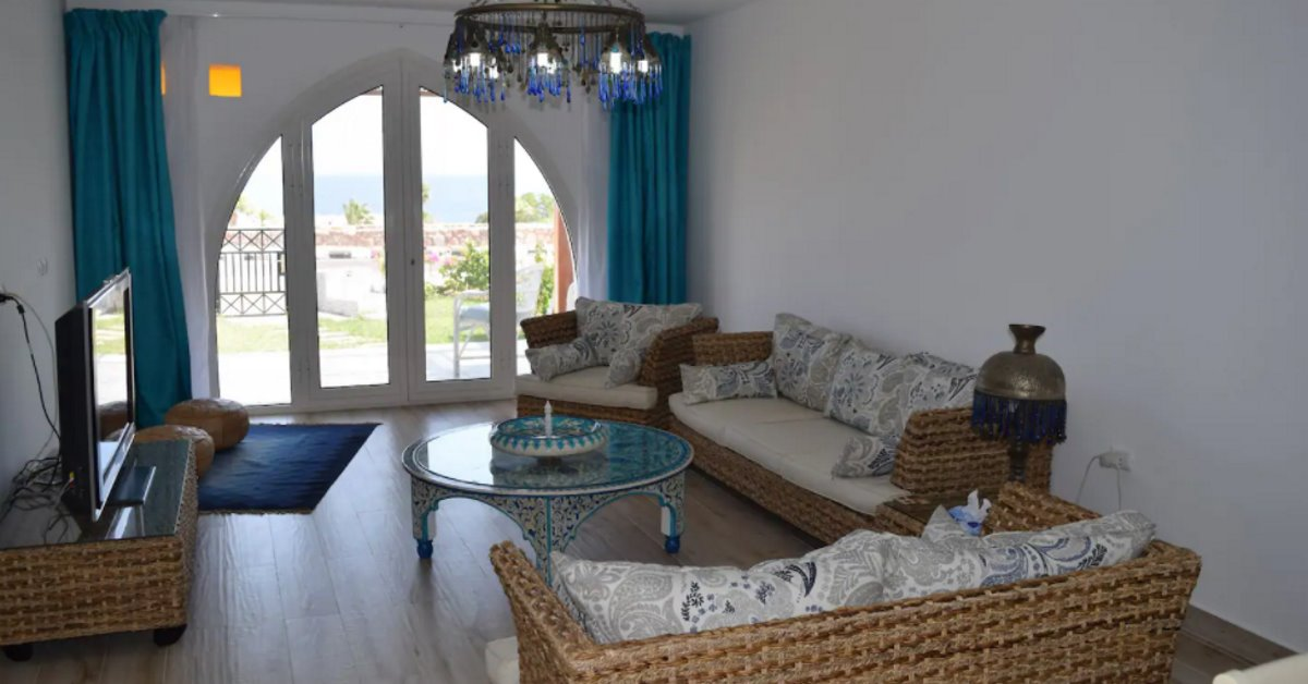 Domina Coral Bay Beach House living room